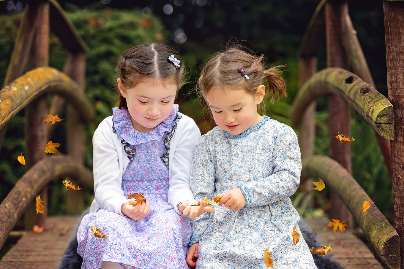 Autumnal outdoor portrait of little girls