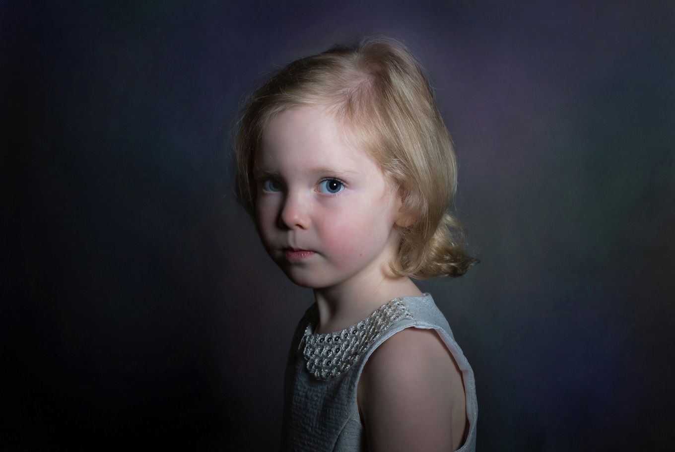 Portrait of a little girl in a studio